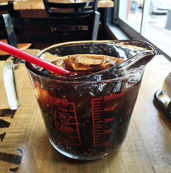 coke in a measuring jug